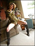 Trans woman in leather boots and panties