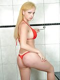 Blonde shemale posing in bikini