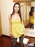 Appealing ladyboy temptingly stripping