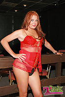 Red haired pornstar in red lingerie solo