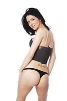 Short haired babe strips her black bikini