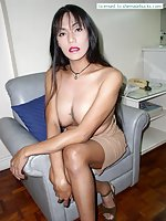 TS With Big Tits & Small Dick Undresses On Chair