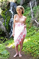 Pretty Delia erect under dress by a waterfall
