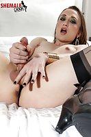 Jaqueline Wood stroking her cock