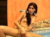 Slender ladyboy in a pool