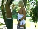 Blonde TS in stockings fucked in the woods