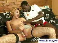 Black guy & white tranny in stockings each other sucking
