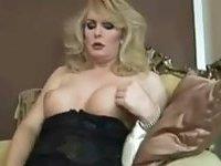 Busty blonde masturbates in black lingerie