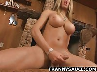 Busty blonde shemale honey tugging on her hard cock