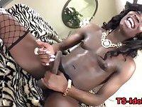 Black tgirl tugs her big pole