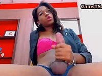 Black latin shemale is stroking her huge cock