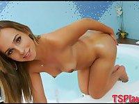 Cute tranny strokes her cock in bathtub