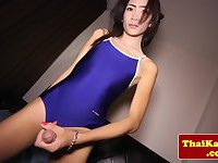 Petite thai ladyboy jerks and pees in glass