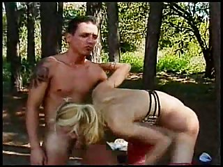 Blonde small tits shemale fucked in forest with cumshot on her t