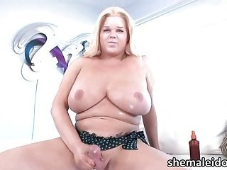 Titty shemale blonde Holly Sweet cums after stroking