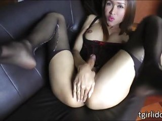 Luscious ladyboy sex kitten Apple rips off her stockings and strokes her cock