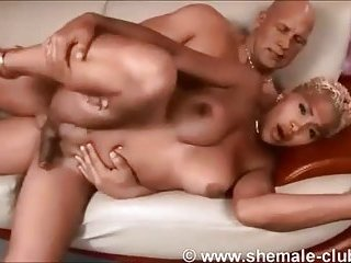 Strong guy fucks shemale with hard cock