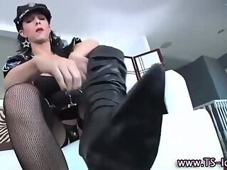 Stockinged shemale cop spanks