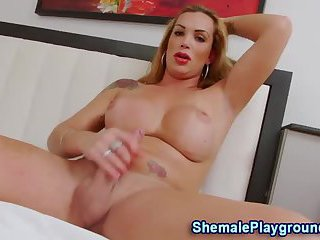 Busty tranny tugs and cums